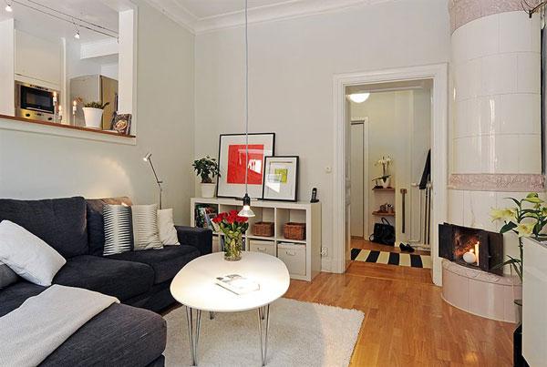 Decoração de sala pequena com sofá de canto.