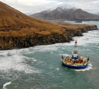The conical oil drilling unit Kulluk sits grounded off the coast of Alaska. Investor fears about carbon assets becoming uneconomic, or stranded, are being exacerbated by companies' pursuit of carbon-intensive projects such as Arctic drilling and Canadian oil sands projects. (Credit: U.S. Coast Guard handout photo taken January 3, 2012) Click to Enlarge.