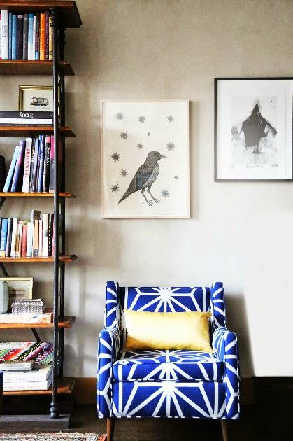 Bold geometric blue armchair and bird print