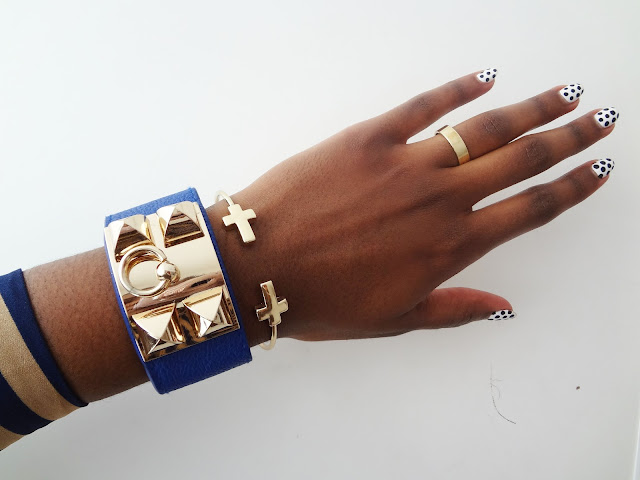 Gold Pyramid Stud Faux Leather Cuff Bracelets blue on wrist.