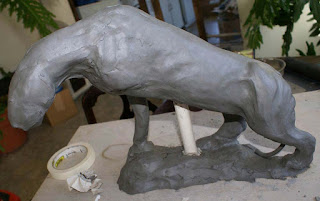 how to sculpt a panther out of clay, building clay panther sculpture, building a clay lion sculpture
