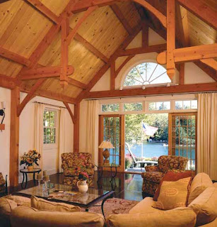 This timber frame great room features a spectacular view of the lake