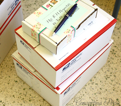stack of priority mail boxes