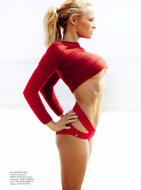 Pamela Anderson hot in a red outfit at a beach