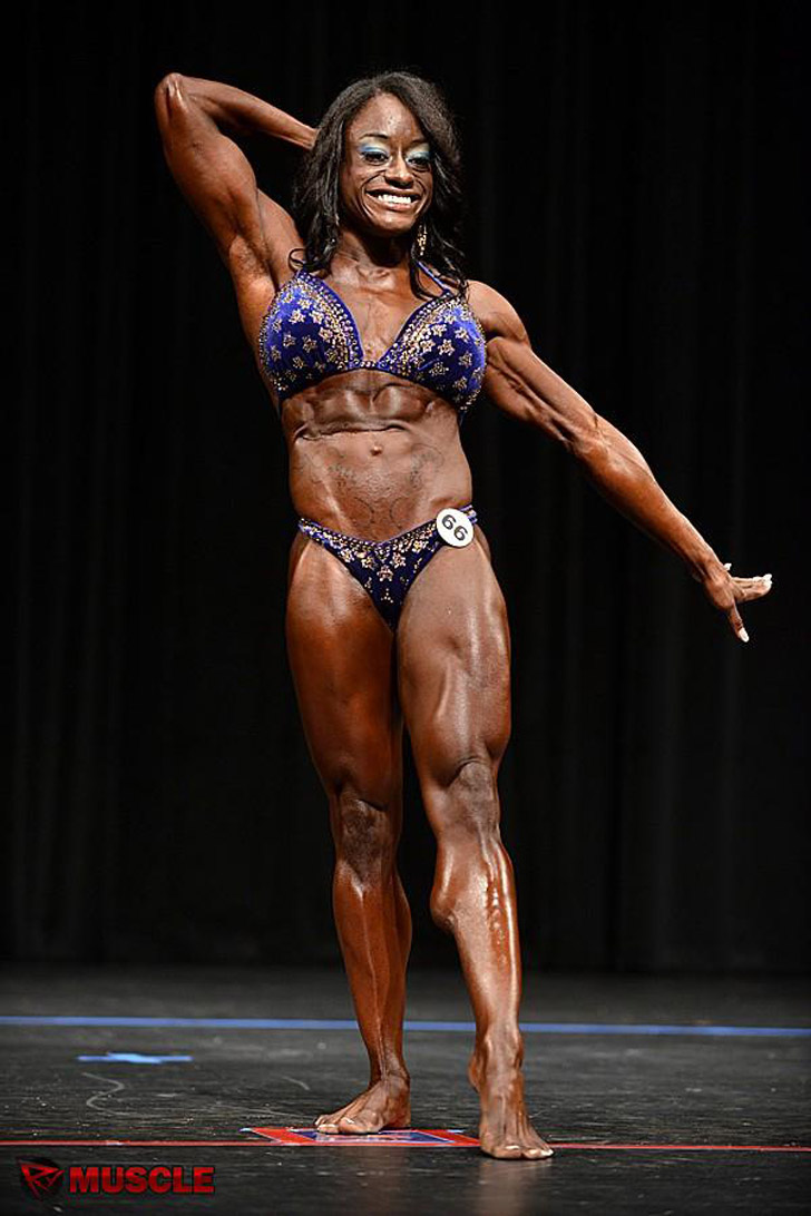 Dominique Furuta flexing her muscles at the 2012 NPC Texas State Competition
