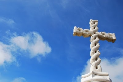 White cross against blue sky