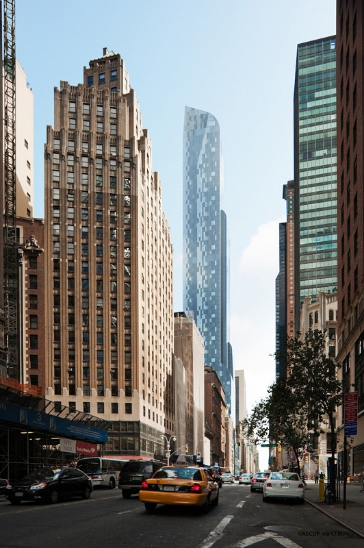 Photo of One57 tower as seen from the street towering above everything 