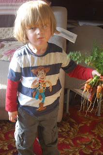 Toddlers growing vegetables.