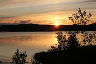Solnedgång över havsvik i Ångermanland