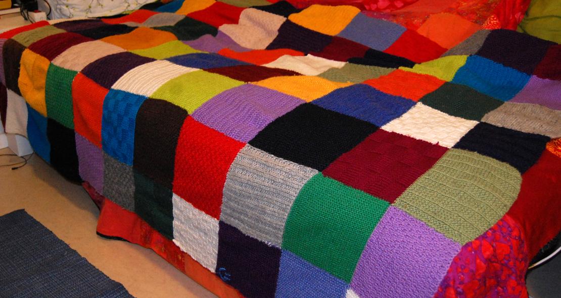 strikke stort teppe