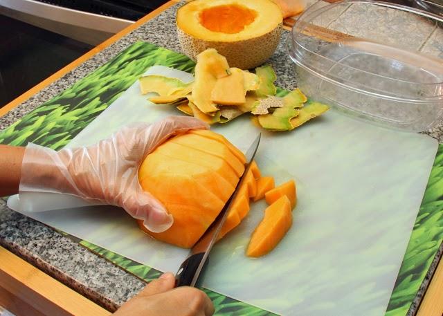 Slice the cantaloupe into chunks.