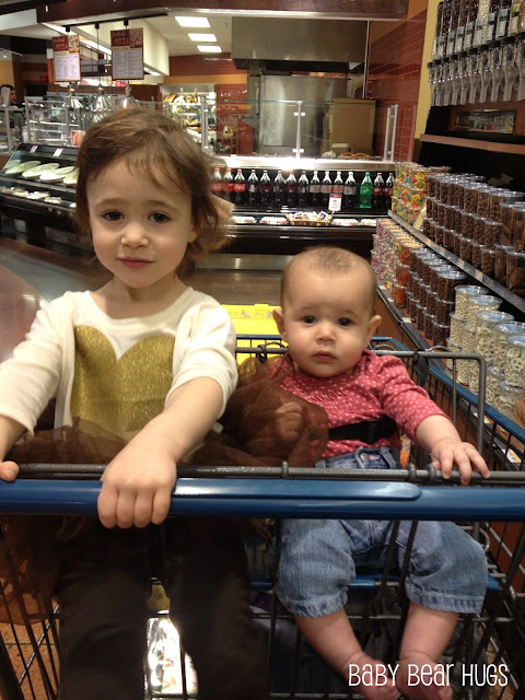 two little girls in a shopping cart