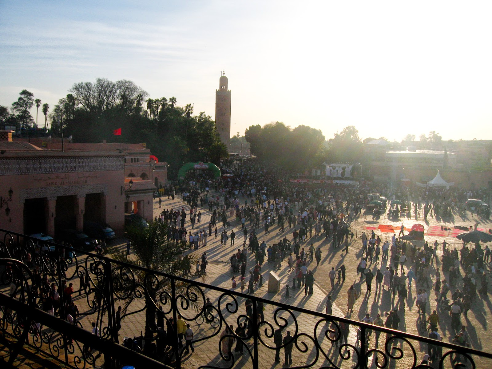 Marrakech top tourist attractions: Jemaa El Fna - grand market of Marrakech during sunset, Koutobia Mosque in the back