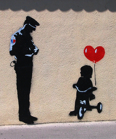 Gadeuorden - disorderly conduct - stencil graffiti with police, little girl, heart and tricycle