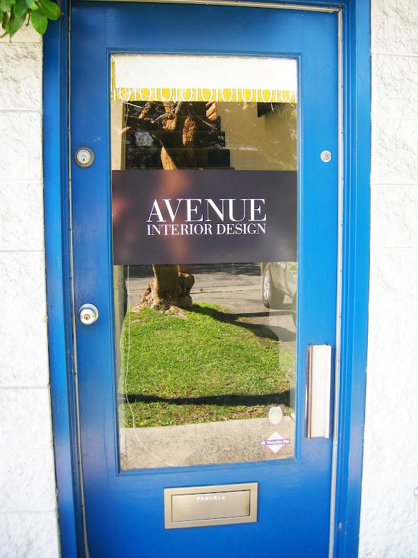 Bright blue front door to Avenue Interior Design
