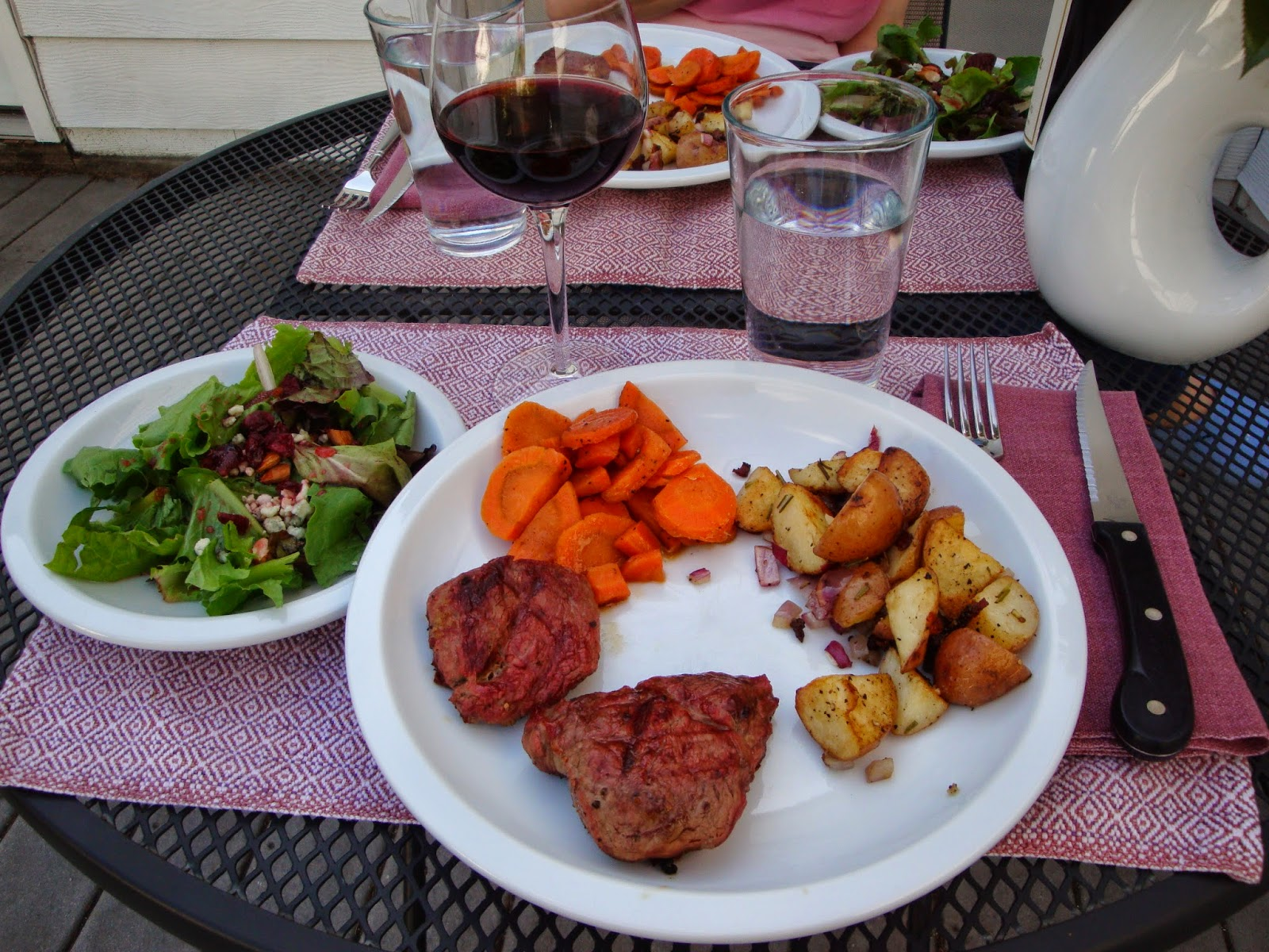 Steak, salad, carrots and potatoes local food pairing with local wine