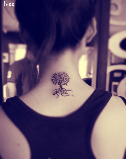 a tree tattoo behind the neck with roots