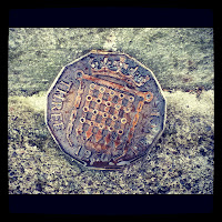 Giant three pence coin outside the RCA in Bristol