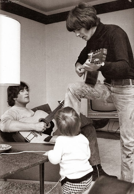 John & Julian Lennon and George Harrison at home in 1965.