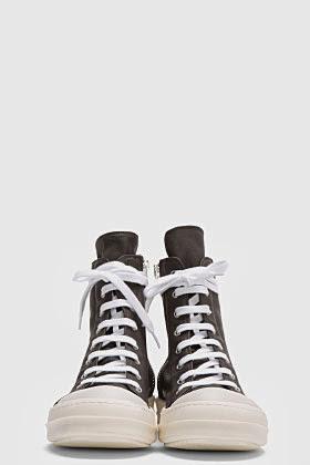 http://www.ssense.com/men/product/rick_owens_drkshdw/black_waxed_cotton_high-top_sneakers/81185