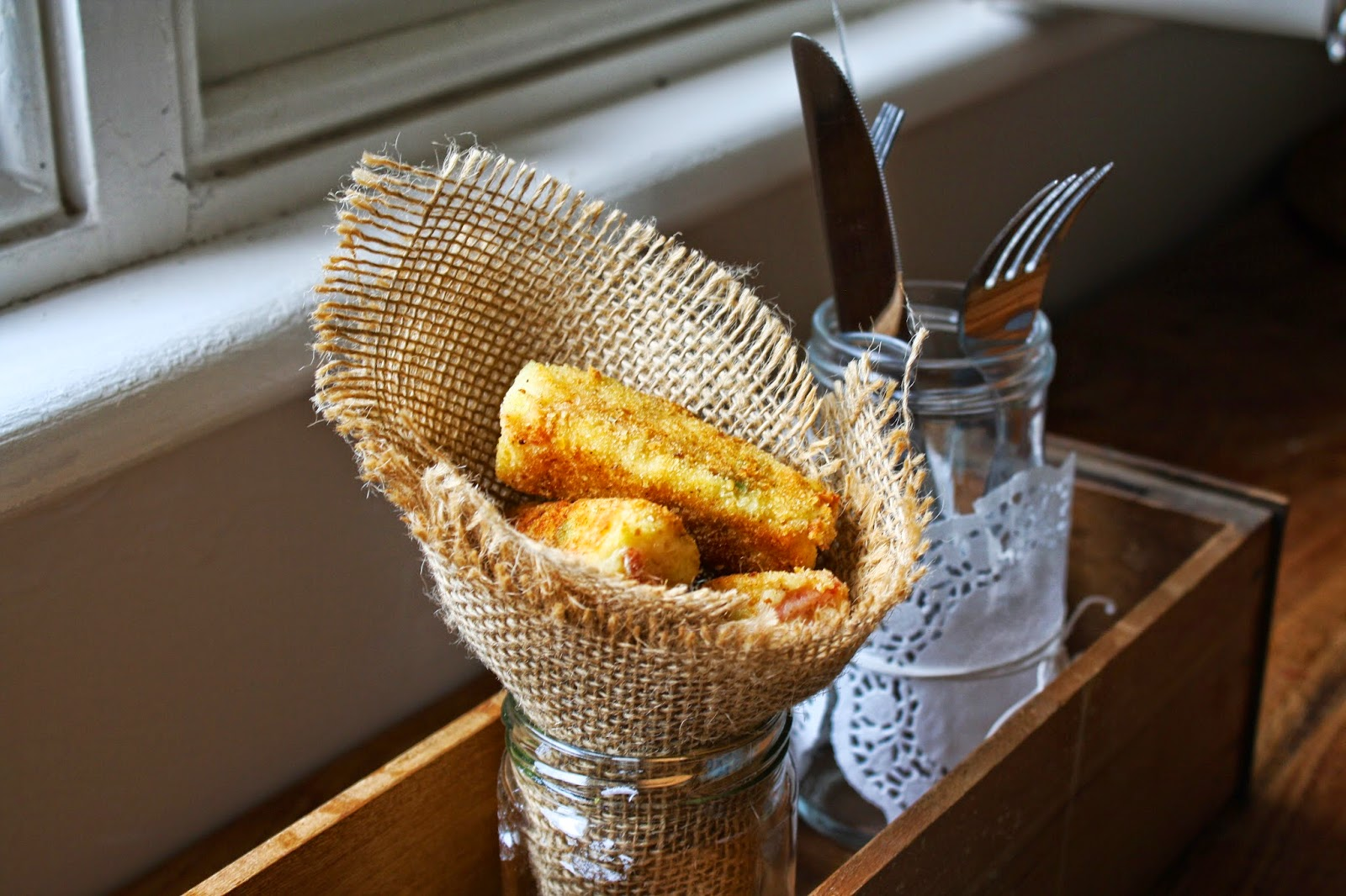 croquettes in a jar with cutlery