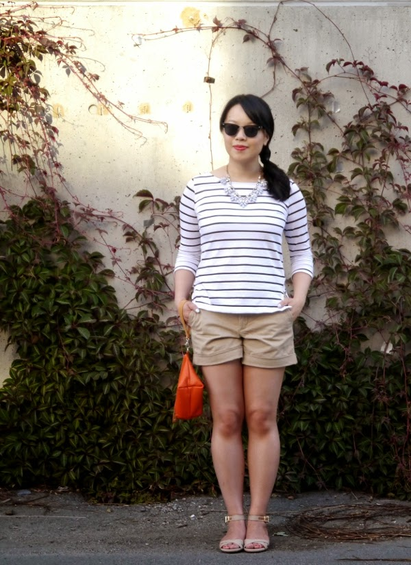 Black and white Breton striped top, statement necklace, khaki shorts, ankle strap mini espadrille wedges, orange wristlet