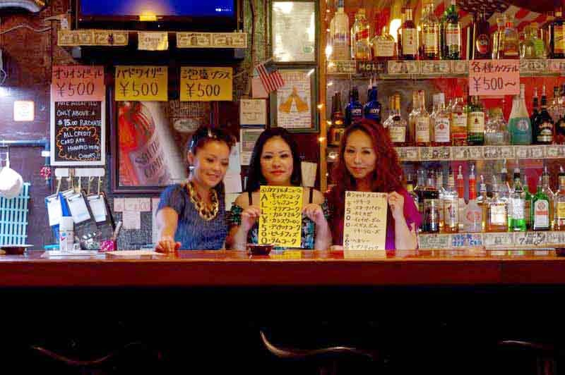 3 girls behind bar
