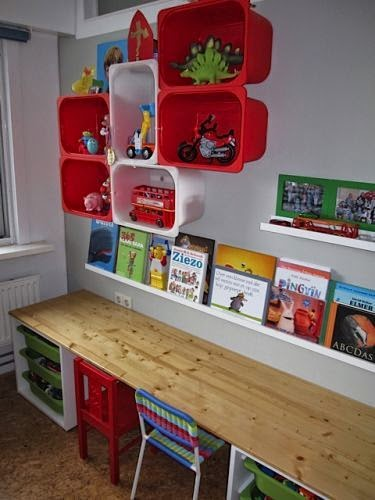 http://followpics.co/colorful-shelving-made-from-ikea-plastic-boxes-i-also-like-how-the-table-workspace-is-done/