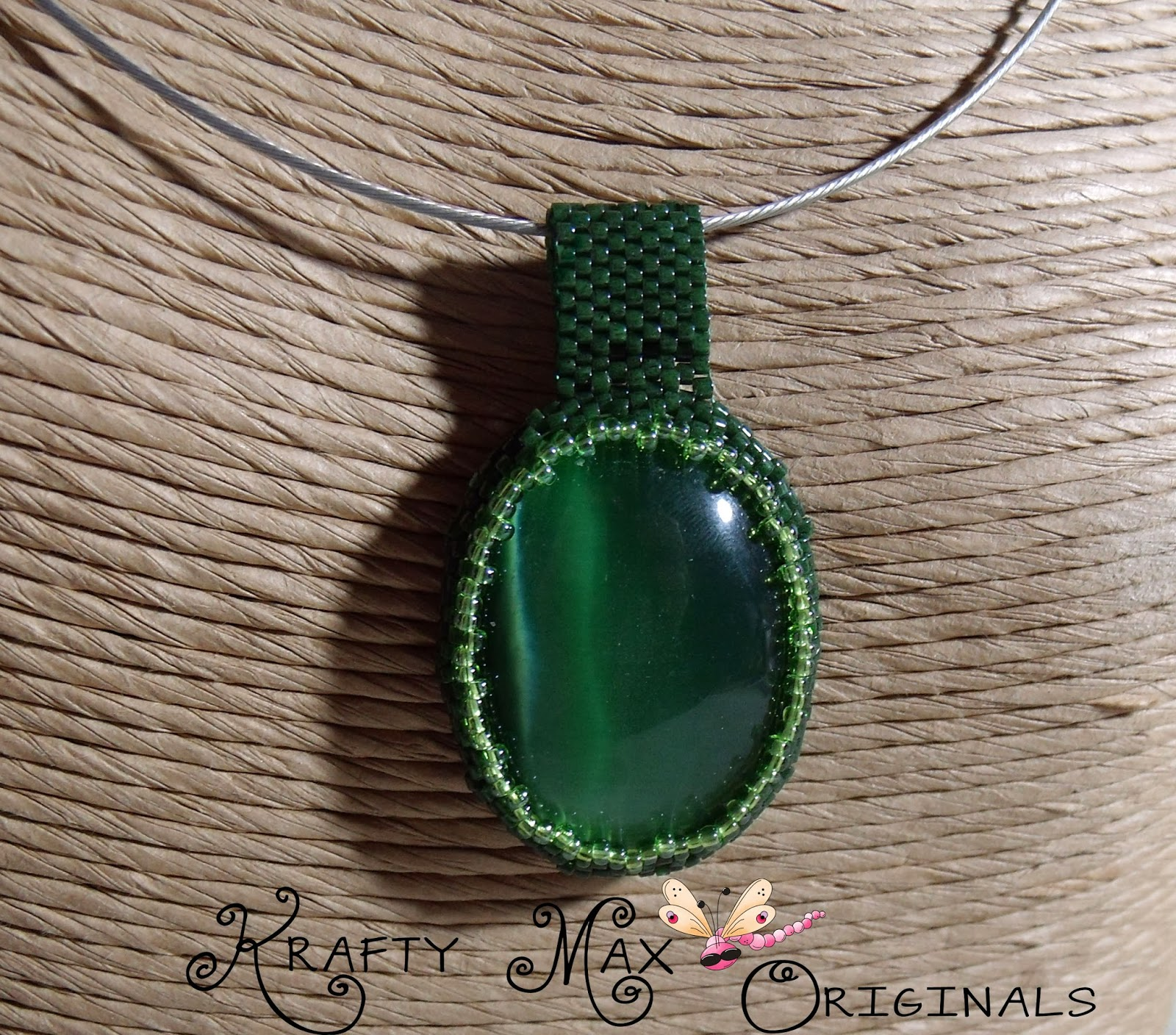 http://www.lajuliet.com/index.php/2013-01-04-15-21-51/ad/beadwork,46/exclusive-green-catseye-beadwoven-necklace-a-krafty-max-original-design,276