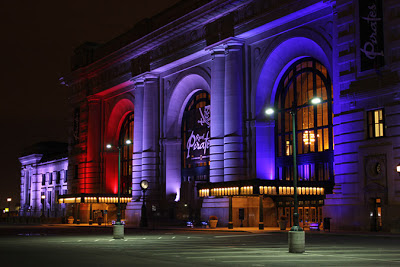 Image of Union Station at night lit in multiple colors