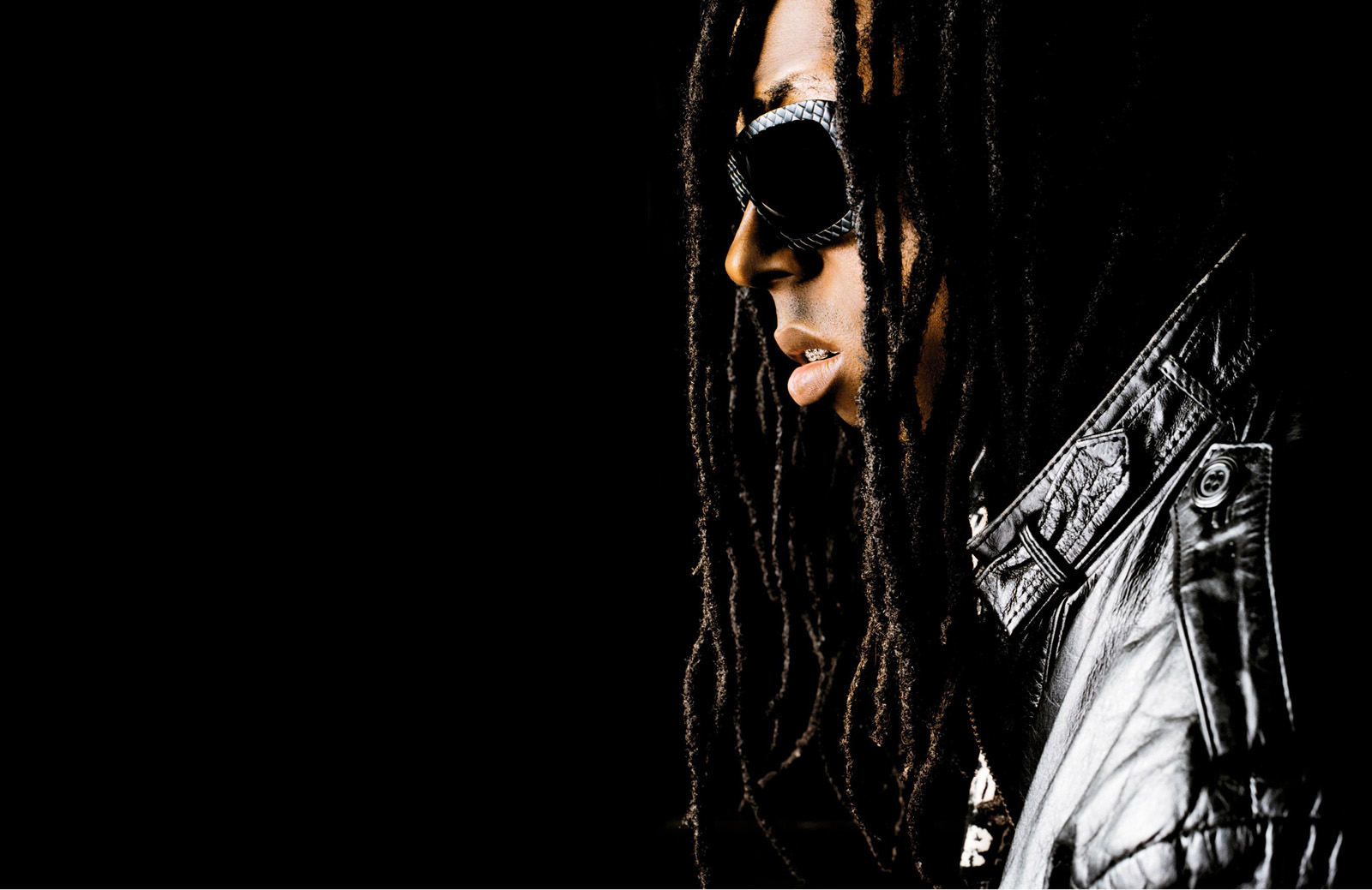 http://3.bp.blogspot.com/-s1YNZu11ddA/TnnhjJPhZDI/AAAAAAAADOE/tc3Qv3HuRQA/s1600/Lil_Wayne_Sun_Glasses_Dark_Background_Vvallpaper.net.jpg