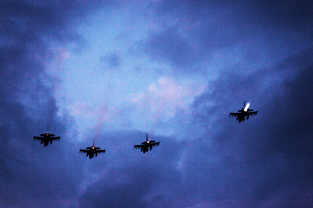 Four fighter jets doing a fly over during Game 3 of the 2011 World Series in Arlington, Texas.