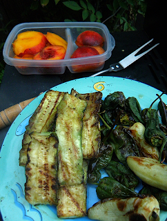 Plate of Grilled Veggies and Container of Peaches