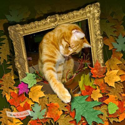 kot w liściach