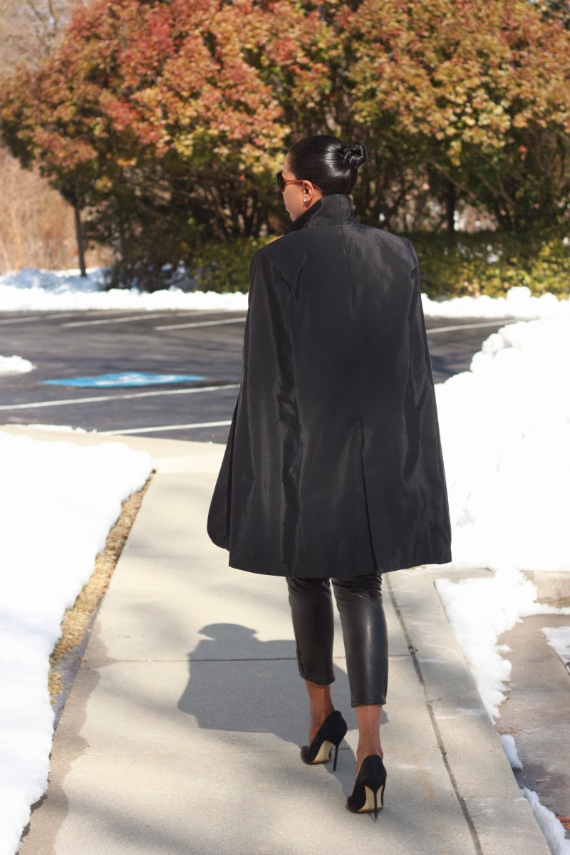 Chic black cape made with designer faille fabric from Mood Fabrics.