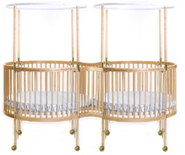 This Round Crib With Two Cribs Joined Mutually At One