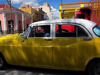 Santiago de Cuba yellow car