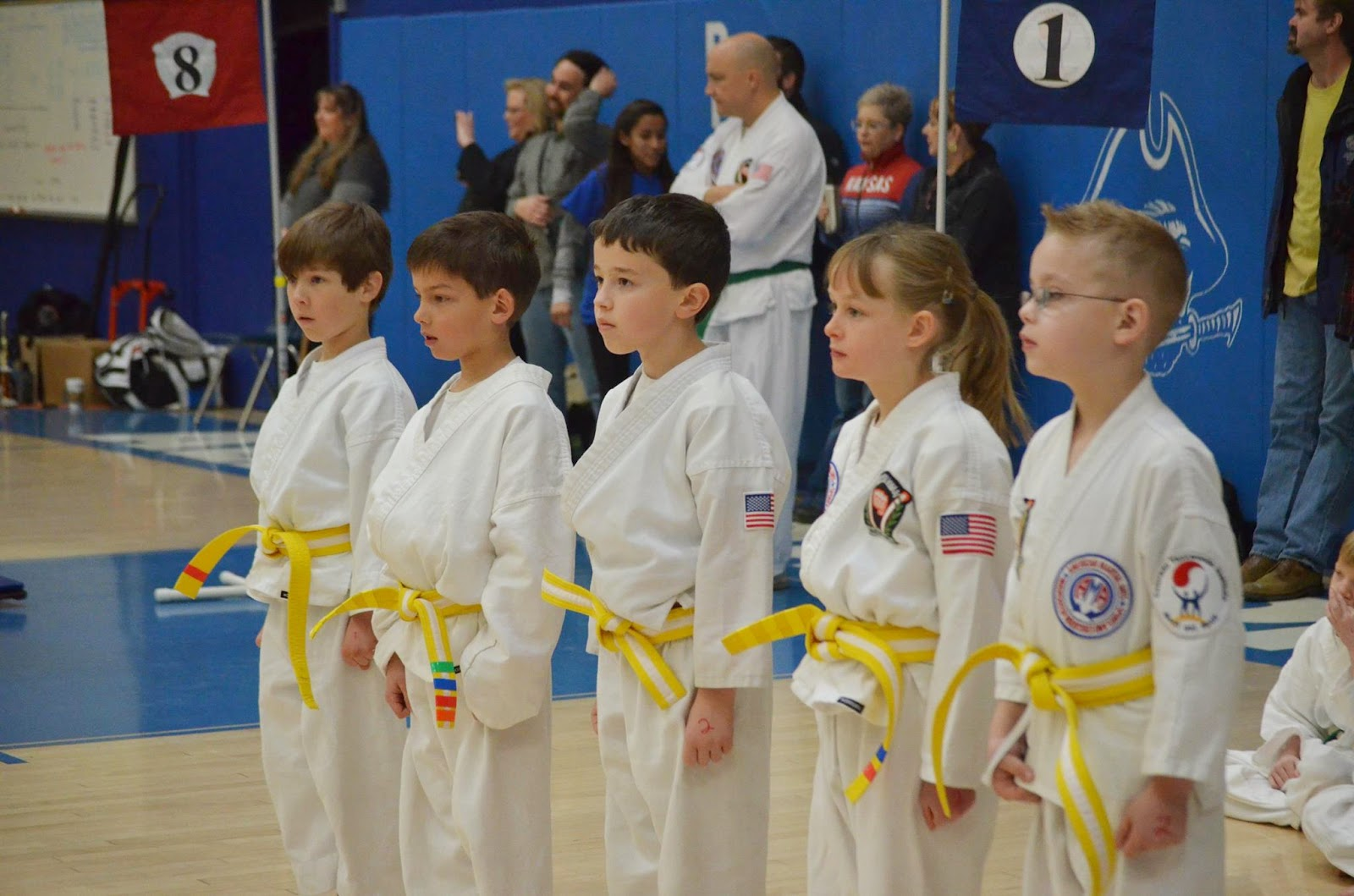 Martial arts students ready to compete at a tournament