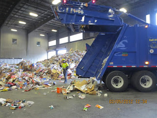Recycling truck unloading paper at the Recycling Center.