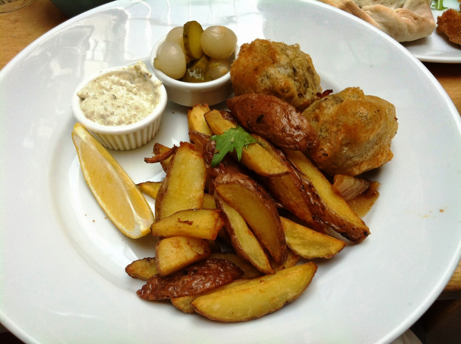 Vegan Vegetarian Haggis Fritters with Hand Cut Chips, Pickles and Tartare Sauce Saramago Cafe Bar Glasgow, Scotland