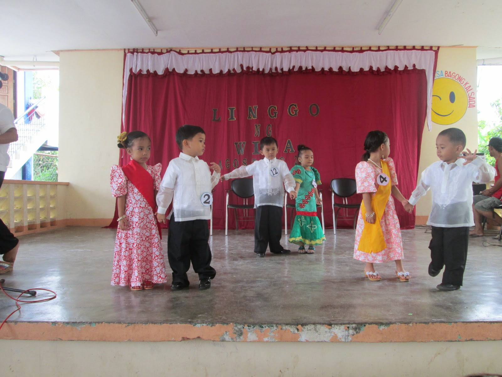 "<img src=""patadyong.gif"" alt=""little kids doing a folk dance wearing Philippines national costumes patadyong and barong "" />"