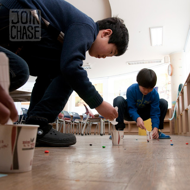 Students competing during an M&M relay race at Winter English Camp at Bibong Elementary in Ochang, South Korea.