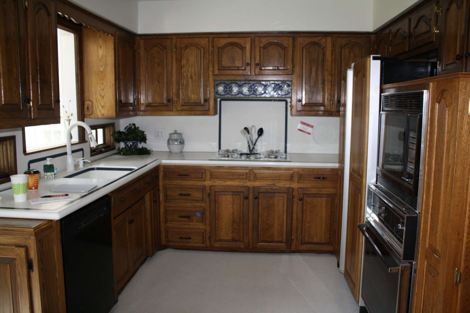 Updating a home on a budget julie blanner for Painting kitchen cabinets