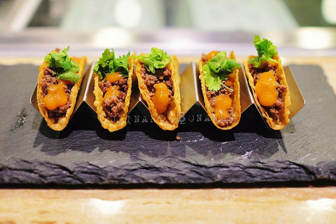 Akira's Tacos - wagyu galbi, spicy tomato ponzu, crispy taco