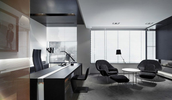 Photo of an amazing home office with dark furniture