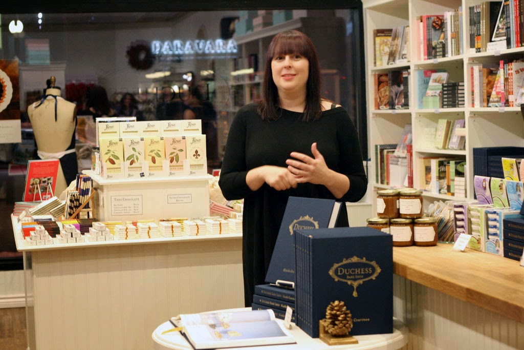 Giselle Courteau explaining the Duchess Bake Shop Cookbook.