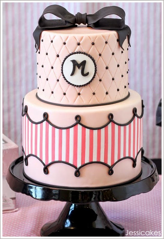 Light pink and black cake with monogram