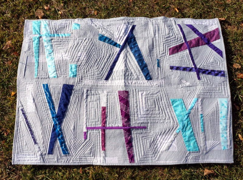 http://quiltyhabit.blogspot.com/2014/10/pixie-sticks-finished-quilt.html