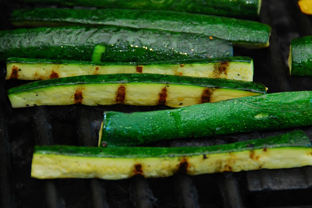 close up of zucchini roasting on grill