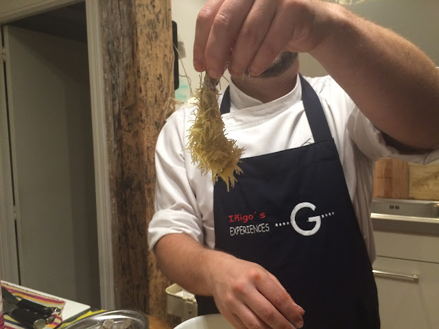 Chef Íñigo with an urchin prawn - Tenedor tours cooking class - San Sebastian